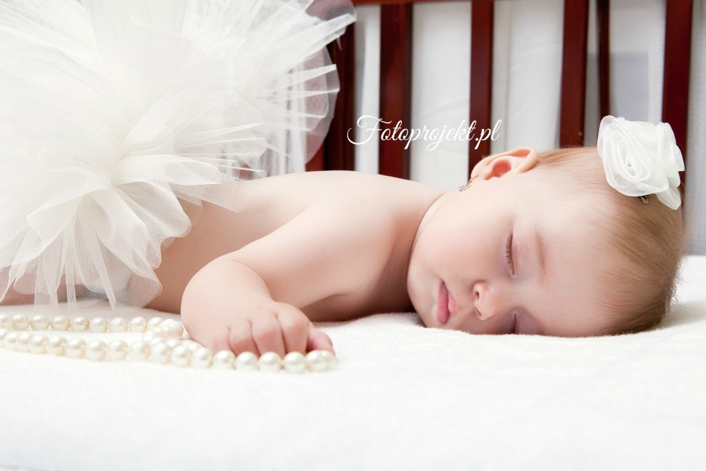 close-up portrait of a beautiful sleeping baby in bed