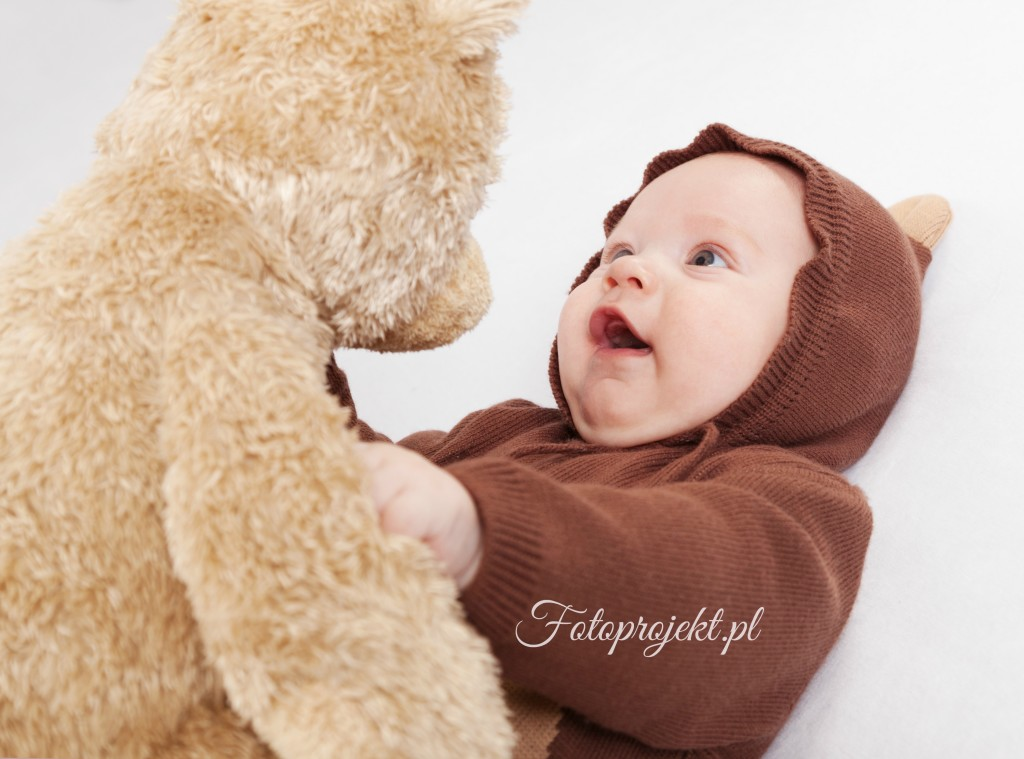 Portrait of the child in a suit of a bear a bear a toy